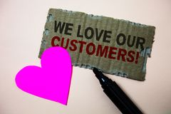 Text sign showing We Love Our Customers Call. Conceptual photo Client deserves good service satisfaction respect Brown paperboard. Rough ideas message heart Royalty Free Stock Images