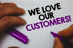 Text sign showing We Love Our Customers Call. Conceptual photo Client deserves good service satisfaction respect Man hold holding. Purple marker notebook page Royalty Free Stock Photos