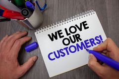 Text sign showing We Love Our Customers Call. Conceptual photo Client deserves good service satisfaction respect Man hold holding. Blue marker notebook page Stock Photos