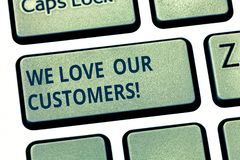Text sign showing We Love Our Customers. Conceptual photo Appreciation for clients good customer service Keyboard key. Intention to create computer message stock image