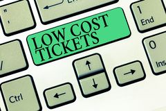 Text sign showing Low Cost Tickets. Conceptual photo small paper bought to provide access to service or show.  stock photo
