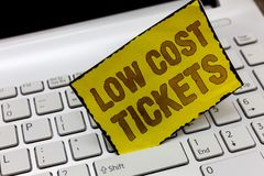Text sign showing Low Cost Tickets. Conceptual photo small paper bought to provide access to service or show.  royalty free stock image