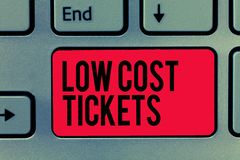 Text sign showing Low Cost Tickets. Conceptual photo small paper bought to provide access to service or show.  stock images