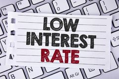 Text sign showing Low Interest Rate. Conceptual photo Manage money wisely pay lesser rates save higher written on Notebook paper p. Text sign showing Low Royalty Free Stock Photo