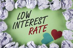Text sign showing Low Interest Rate. Conceptual photo Manage money wisely pay lesser rates save higher written on plain green back. Text sign showing Low royalty free stock images