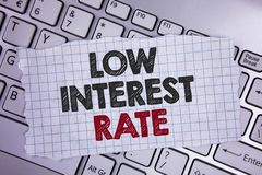 Text sign showing Low Interest Rate. Conceptual photo Manage money wisely pay lesser rates save higher written on Tear Notebook pa. Text sign showing Low stock images