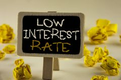 Text sign showing Low Interest Rate. Conceptual photo Manage money wisely pay lesser rates save higher written on Wooden Notice Bo. Text sign showing Low royalty free stock image