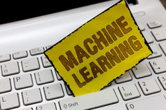 Text sign showing Machine Learning. Conceptual photo give computers the ability to be taught with data.  stock image