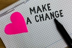Text sign showing Make A Change. Conceptual photo Create a Difference Alteration Have an Effect Metamorphose Squared notebook pape. R ripped sheets Marker stock photos