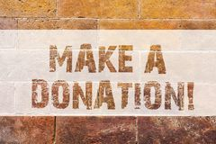 Text sign showing Make A Donation. Conceptual photo Donate giving things not used any more to needed showing Brick Wall royalty free stock photo