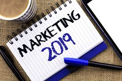 Text sign showing Marketing 2019. Conceptual photo New Year Market Strategies Fresh start Advertising Ideas written on Notebook Bo. Text sign showing Marketing stock photo