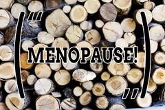 Text sign showing Menopause. Conceptual photo Cessation of menstruation Older women hormonal changes period Wooden. Text sign showing Menopause. Business photo royalty free stock photos