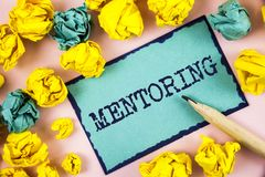 Text sign showing Mentoring. Conceptual photo To give advice or support to a younger less experienced person written on Sticky Not. Text sign showing Mentoring Stock Photography