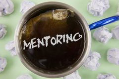 Text sign showing Mentoring. Conceptual photo To give advice or support to a younger less experienced person written on Black Tea. Text sign showing Mentoring Stock Image