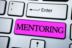 Text sign showing Mentoring. Conceptual photo To give advice or support to a younger less experienced person written on Pink Key B. Text sign showing Mentoring Royalty Free Stock Images