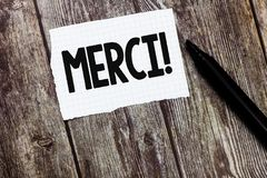 Text sign showing Merci. Conceptual photo defined as thank you in French language Being grateful to someone royalty free stock images