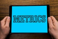 Text sign showing Metrics. Conceptual photo Method of measuring something Study poetic meters Set of numbers written on Tablet Scr. Text sign showing Metrics Stock Images
