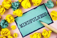 Text sign showing Mindfulness. Conceptual photo Being Conscious Awareness Calm Accept thoughts and feelings written on Sticky Note. Text sign showing Mindfulness Royalty Free Stock Image