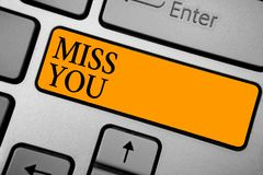 Text sign showing Miss You. Conceptual photo Longing for an important person in your life for a period of time Keyboard orange key. Intention create computer royalty free illustration