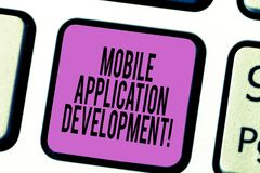 Text sign showing Mobile Application Development. Conceptual photo Writing software for digital devices Keyboard key Intention to. Create computer message stock photos