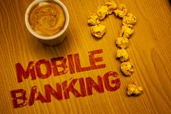 Text sign showing Mobile Banking. Conceptual photo Online Money Payments and Transactions Virtual Bank Words written Desk Coffee W. Hite mug crumbled paper notes royalty free stock photography