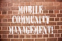 Text sign showing Mobile Community Management. Conceptual photo building relationships with online community. stock photo