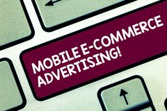 Text sign showing Mobile E Commerce Advertising. Conceptual photo use of mobile devices in marketing brand Keyboard key. Intention to create computer message royalty free stock image