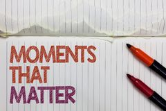 Text sign showing Moments That Matter. Conceptual photo Meaningful positive happy memorable important times White torn page writte. N some letters beside laid stock photo