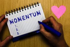 Text sign showing Momentum. Conceptual photo quantity of motion of moving measured as product mass and velocity Man. Holding marker notebook page heart romantic stock photography