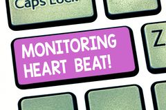 Text sign showing Monitoring Heart Beat. Conceptual photo Measure or record the heart rate in real time Keyboard key. Intention to create computer message royalty free stock photos