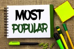 Text sign showing Most Popular. Conceptual photo Top Rating Bestseller Favorite Product or Artist 1st in ranking written on Notebo. Text sign showing Most stock photography
