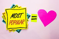 Text sign showing Most Popular. Conceptual photo Top Rating Bestseller Favorite Product or Artist 1st in ranking written on Yellow. Text sign showing Most Stock Photography