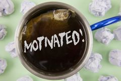 Text sign showing Motivated Motivational Call. Conceptual photo Willing to do something Inspired Confident written on Black Tea in. Text sign showing Motivated Royalty Free Stock Photography
