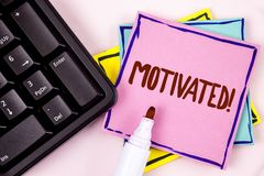 Text sign showing Motivated Motivational Call. Conceptual photo Willing to do something Inspired Confident written on Pink Sticky. Text sign showing Motivated Stock Images