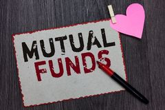 Text sign showing Mutual Funds. Conceptual photo An investment program funded by shareholders Individual Stocks White page red bor