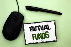 Text sign showing Mutual Funds. Conceptual photo Investment Strategy to purchase shares with other investors written on Sticky Not. Text sign showing Mutual Royalty Free Stock Photo
