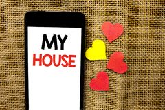 Text sign showing My House. Conceptual photo Housing Home Residential Property Family Household New Estate written on Cardboard Pi. Text sign showing My House Stock Image