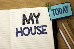 Text sign showing My House. Conceptual photo Housing Home Residential Property Family Household New Estate written on Notebook Boo Stock Photos