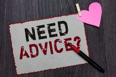 Text sign showing Need Advice question. Conceptual photo Asking someone if he want recommendations or guidance White page red bord. Ers marker clothespin holds stock photo