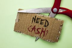 Text sign showing Need Cash Question. Conceptual photo Wealth Question Needy Currency Money Advice Conceptual written on Tear Card. Text sign showing Need Cash Stock Photography
