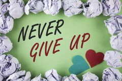 Text sign showing Never Give Up. Conceptual photo Be persistent motivate yourself succeed never look back written on plain green b stock photos
