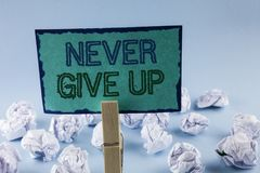 Text sign showing Never Give Up. Conceptual photo Be persistent motivate yourself succeed never look back written on Sticky Note P. Text sign showing Never Give Royalty Free Stock Photography