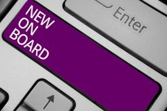 Text sign showing New On Board. Conceptual photo Welcome to the team Adaptation Collaboration Someone hired Keyboard purple key In. Tention create computer stock photography