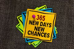 Text sign showing 365 New Days New Chances. Conceptual photo Starting another year Calendar Opportunities Black bordered different. Color sticky note stick royalty free stock image