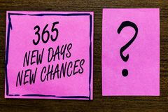 Text sign showing 365 New Days New Chances. Conceptual photo Starting another year Calendar Opportunities Violet color black lined. Sticky note with letters stock photography