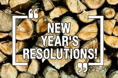 Text sign showing New Year S Resolutions. Conceptual photo Goals Objectives Targets Decisions for next 365 days Wooden background. Vintage wood wild message royalty free stock images
