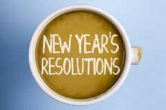 Text sign showing New Year\'S Resolutions. Conceptual photo Goals Objectives Targets Decisions for next 365 days written on Coffee. Text sign showing New Year\'S Stock Photography