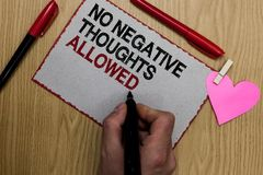 Text sign showing No Negative Thoughts Allowed. Conceptual photo Always positive motivated inspired good vibes Written sticky note. Clip pinch heart hand hold Stock Photos