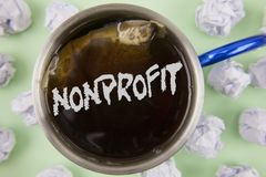 Text sign showing Nonprofit. Conceptual photo Activities that do not generate revenues to the executor written on Black Tea in Cup. Text sign showing Nonprofit Stock Photo
