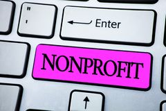 Text sign showing Nonprofit. Conceptual photo Activities that do not generate revenues to the executor written on Pink Key Button. Text sign showing Nonprofit Royalty Free Stock Image